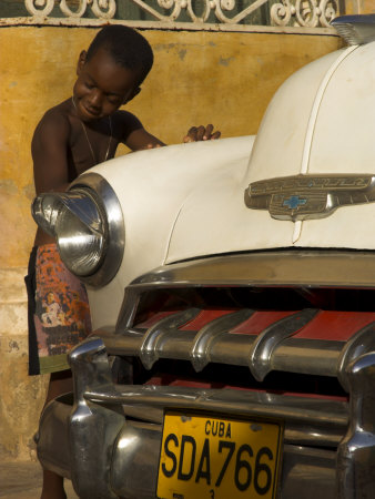 Young Boy Drumming on Old American Car's Bonnet,Trinidad, Sancti Spiritus Province, Cuba Posters