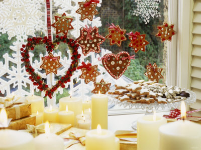 Christmassy Window Decorated with Biscuits and Candles