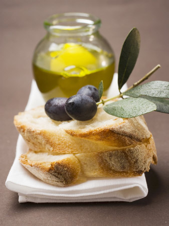 Olive Sprig with Black Olives on White Bread, Olive Oil Behind
