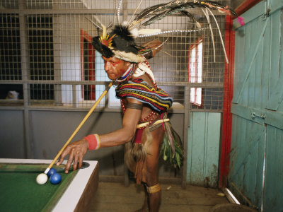 A Huli Wigman Plays Pool in a Pub During the Annual Sing-Sing in Goroka