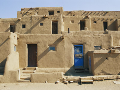 Bright Sunshine Casts Harsh Shadows on This Southwestern Adobe Pueblo Structure