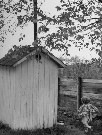 Small Child Running to the Outhouse at Rural School