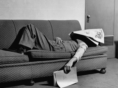 Writer Niven Busch Lying on Sofa with Newspaper over His Face as He Takes Nap from Screenwriting