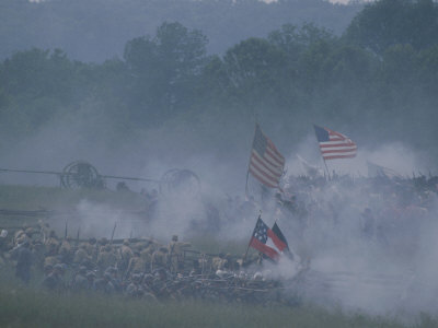 Flags, Soldiers, and Gun Smoke During a Civil War Reenactment