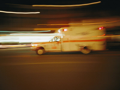 An Ambulance Rushes Past at Night