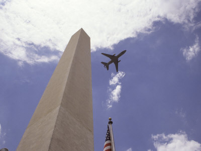 Plane Flying above Washington Monument and United States Flag