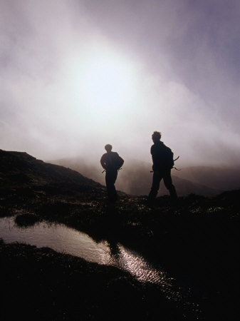 Walkers in Mist on Diamond Hill in Connemara National Park, Connemara, Ireland