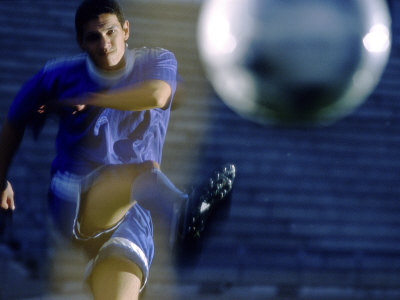 Buy Soccer Player Kicking a Soccer Ball at AllPosters.com