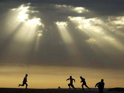 Iraqi Kurdish Boys Play Football as the Sun Sets