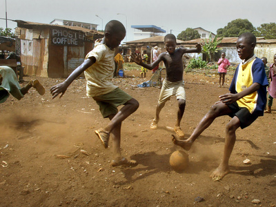 Buy Young Children Play Soccer on a Dirt Pitch by the Side of Railway Tracks at AllPosters.com