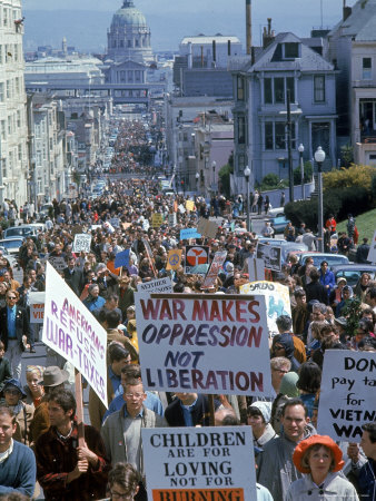 Students Carrying Antiwar Signs While Marching in Protest of US Involvement in the Vietnam War