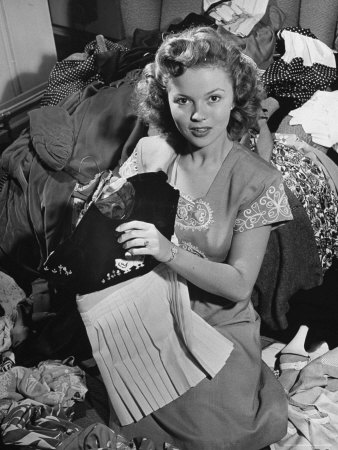 Actress Shirley Temple, Gathering Her Unwanted Clothes Together to Donate to a Clothing Drive