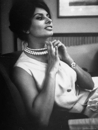 Actress Sophia Loren Fingering Her Pearl Necklace