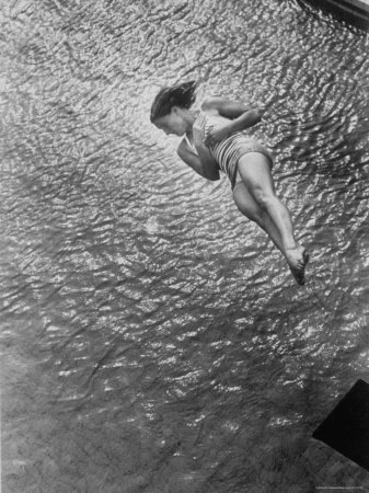 Gold Medalist US Diver Pat McCormick Diving from Springboard at 1952 Olympic Games