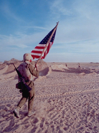 US Marine Carrying American Flag to Free Kuwait from Iraqi Occupation