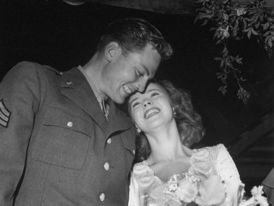 Shirley Temple Cuddling with Her Husband at the Wedding Reception