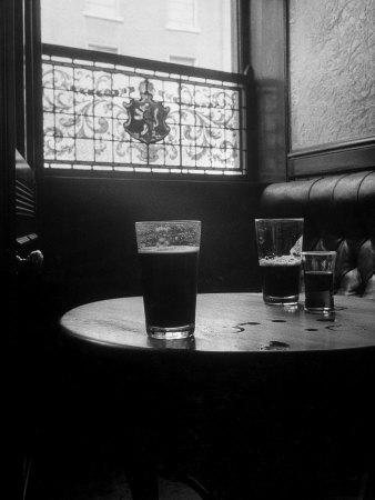 Half Empty Glasses of Beer Left on Table in the Blue Lion Pub in Dublin