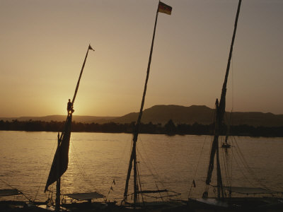 Moored Feluccas on the Nile River at Sunset