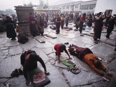 Buddhist Pilgrims Outside Jokhang Temple in Lhasa, Tibet