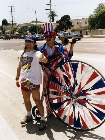 Bruce Dickinson With Rock Group Iron Maiden Standing Beside Man Dressed In Uncle Sam Suit..
