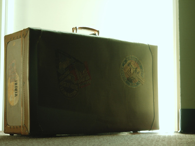 Vintage Suitcase Covered in Travel Tags