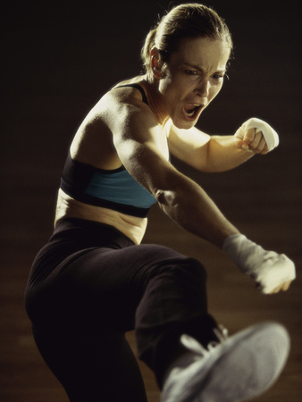 Young Woman Kickboxing