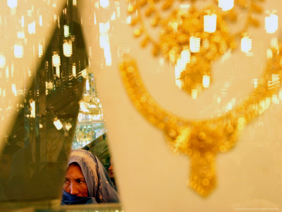 An Afghan Woman Looks for Gold at a Gold Shop