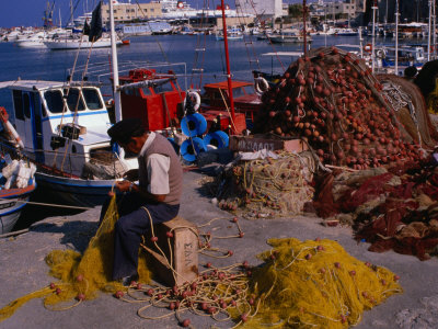 Fisherman Mending His Nets on Waterfront in Herakleion, Greece