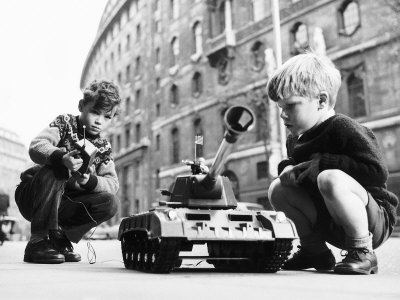 Two Boys Playing with a Remote Controlled Tank