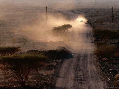 Dust Cloud Following a Car Travelling Down a Gravel Road, Wadi Surmayni, Shuwayhah