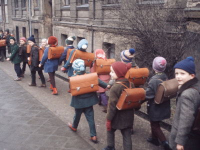 School Children Walking to School with Book Bags on their Backs, East Germany