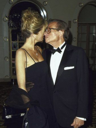 Television Personality Larry King Kissing Wife Shawn at Amfar Benefit