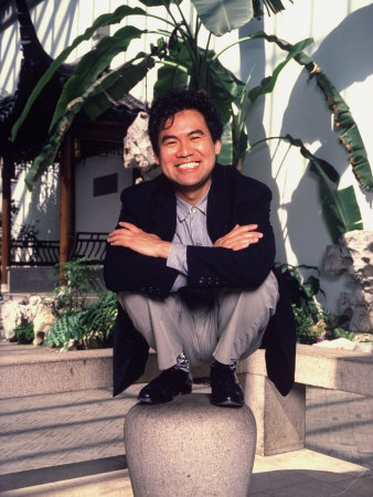 Asian-American Playwright David Henry Hwang Posed Crouching on a Law Stone Pedestal