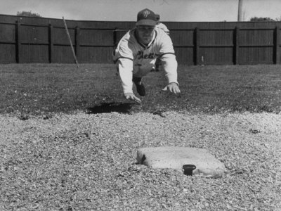 Baseball Player Richie Ashburn Making a Belly-Whopper Slide into Base During Practice