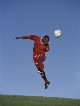 Buy Soccer Player in Action at AllPosters.com