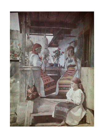 Three Bandanna Clad Girls Sit on a Porch, Spinning Wool