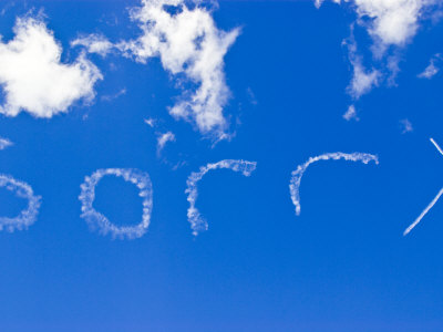 Plane Sign Writer Paints Sorry into a Clear Blue Sky with Smoke