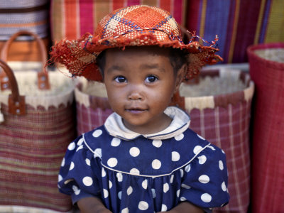 Young Girl Beside a Road-Side Stall Near Antananarivo, Capital of Madagascar