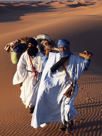 Berber Tribesmen Lead their Camels Through the Sand Dunes of the Erg Chegaga, in the Sahara Region