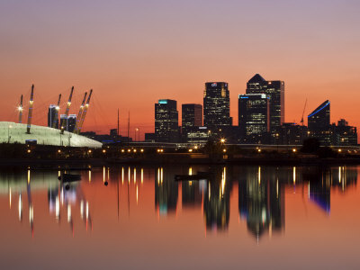 London, Newham, O2 Arena and Canary Wharf Buildings Reflecting in Royal Victoria Docks, England
