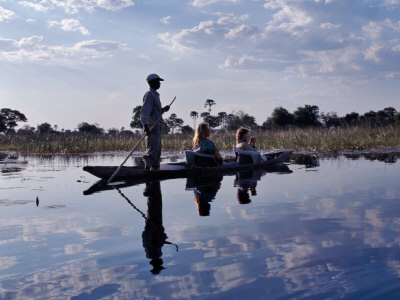 Mokoro Dug-Out Canoe Takes Tourists Along One of Myriad Waterways of Okavango Delta