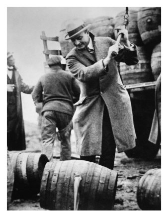 US Federal Agent Broaching a Beer Barrel from an Illegal Cargo During the American Prohibition Era