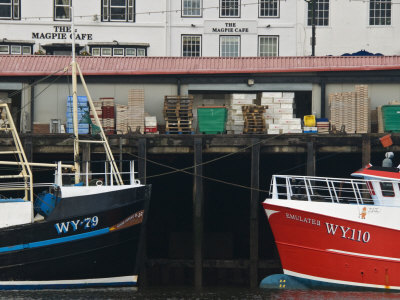 Fishing Boats in Whitby Harbour with Famous Magpie Cafe in Background, Yorkshire, England