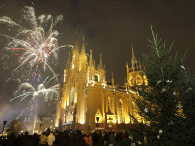 Merry Christmas in Russian - People Celebrate Christmas Eve in Front of Moscow's Catholic Church of Immaculate Conception, Russia