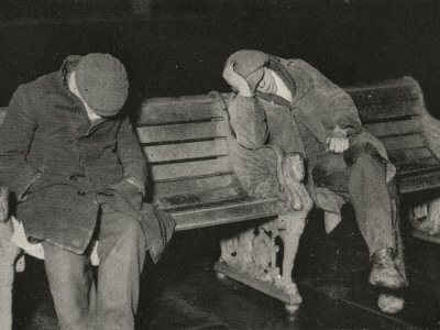 Vagrants Asleep on Bench on Thames Embankment, London