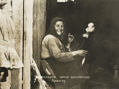 A Macedonian Woman Spinning Wool in Her Cottage