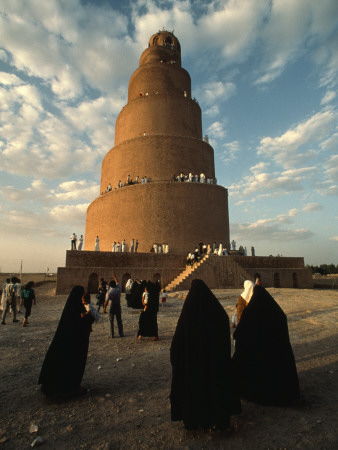 Women Shrouded in Black Approach the Spiral Minaret at Samarra