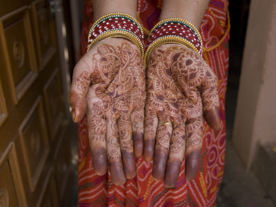 A Henna Tattoo Is Painted on Hands ...