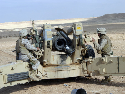 US Marines Prepare to Fire a Howitzer Near Baghdad, Iraq, January 6, 2007