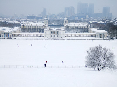 Maritime Museum, Royal Naval College and Canary Wharf Covered in Snow, from Greenwich Park
